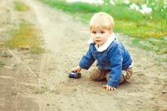A boy plays in the sand Royalty Free Stock Images