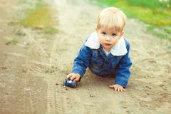 A boy plays in the sand Stock Image