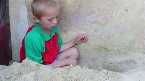Boy plays sand stock video