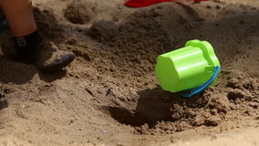 A boy plays in the sandbox stock video footage