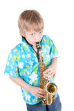 Boy plays a saxophone Royalty Free Stock Images
