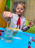 A boy plays in the scientist chemist Stock Photos