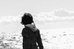 Boy plays at the seaside. In the wind Stock Photos