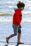 Boy plays at the seaside Royalty Free Stock Photography