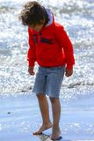 Boy plays at the seaside. In the wind Royalty Free Stock Photography