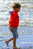 Boy plays at the seaside Royalty Free Stock Photo