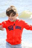 Boy plays at the seaside Stock Photography