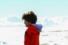 Boy plays at the seaside. In the wind Royalty Free Stock Photos