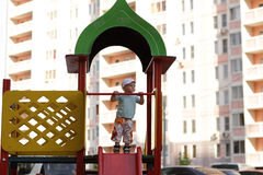 Boy plays on slide Stock Images