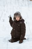 A boy plays in the snow Stock Images