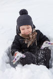 Boy plays in the snow Stock Photos