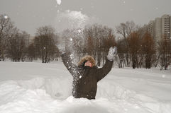 Boy plays with snow Stock Photography