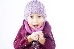 Boy plays snow in winter isolated over white Royalty Free Stock Image