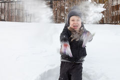 Boy plays in the snow Stock Photography