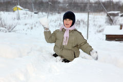 Boy plays in snowball Stock Photography