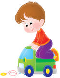 Boy plays with a toy car. Isolated clipart illustration of a boy that plays with his green toy truck Royalty Free Stock Photography