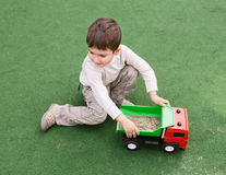 Boy plays with toy car Royalty Free Stock Images