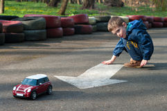 Boy plays with a toy car. Four year old boy plays with the car. Season - spring Royalty Free Stock Photo