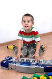 Boy plays the toy piano. Young boy playing toy piano Stock Photo