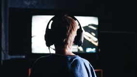 The boy plays a video game. The view from the back. Great plan. Children`s entertainment. Emotionally stock video footage