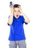 Boy plays video games Stock Photo