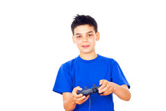 Boy plays video games Royalty Free Stock Photo