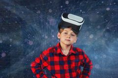 The boy plays virtual educational games . Modern technologies in training. Virtual world of technology. A child plays in a virtual reality royalty free stock images