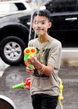 Boy plays water pistols Stock Photo