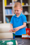Boy plays with wooden cubes Royalty Free Stock Photo