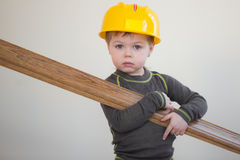 Boy with plinth in his hands. Boy in protective helmet keaping plinth in his hands Royalty Free Stock Image