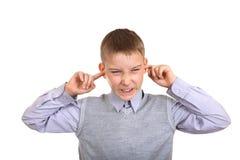 Boy plug the Ears Royalty Free Stock Photos