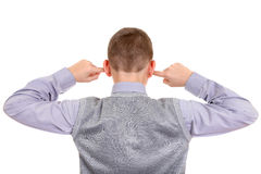 Boy plug the Ears. Rear view of a Boy with cover Ears Isolated on the White Background stock photos