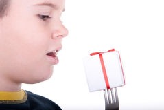 Boy and a plug with a gift. On a white background Stock Photography