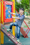 Boy plying in playground Royalty Free Stock Images