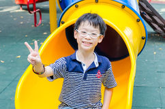 Boy plying in playground Royalty Free Stock Photography