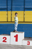 Boy on the podium Stock Photos