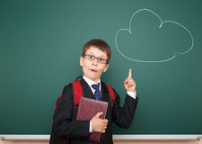 Boy point at drawing cloud and having idea Stock Photography