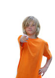 Boy Pointing. Young boy in orange t-shirt pointing strait ahead Royalty Free Stock Photography