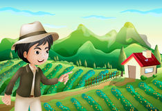 A boy pointing at the barnhouse at the farm Stock Photo