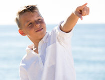 Boy pointing beach Stock Photography