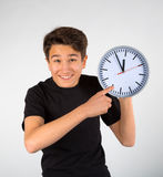 Boy pointing at clock Stock Photos