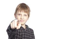 Boy pointing finger Stock Photos