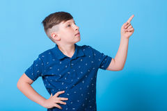 Boy pointing at Stock Photography