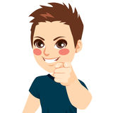 Boy Pointing Finger. Portrait of happy positive young teenager boy smiling pointing with finger something Royalty Free Stock Photo