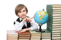 A boy is pointing on a globe Royalty Free Stock Photography