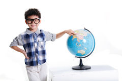 Boy pointing at globe Stock Image