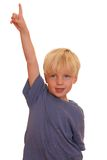 Boy pointing high Stock Photography