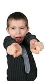 Boy pointing his two fingers. Boy with mouth open and pointing his two fingers Royalty Free Stock Images