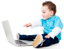 Boy pointing at a laptop Royalty Free Stock Photo