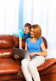 Boy pointing at laptop's monitor and his mother Royalty Free Stock Photo